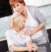 Mother soothes sad daughter — Stock Photo