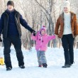 Family walking in a winter park — Photo