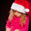 Girl writing a letter to santa claus — Stock Photo #31997579