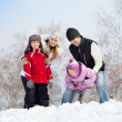 Happy family in winter park — Stockfoto