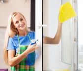 Woman washing window — Stock Photo