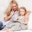 Mother and daughter wiht tablet at sofa — Stock Photo #34119175