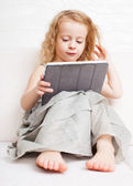 Baby with tablet computer — Stock Photo