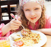 Child eating pasta — Stock Photo