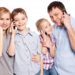 Parents with children with mobile phone — Stock Photo