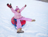 Child sledding in winter hill — Stock Photo