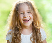 Laughing girl on grass — Stock Photo