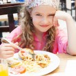 Stock Photo: Child eating pasta