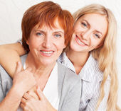 Mother with daughter at home — Stock Photo