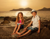 Children at sunset — Stock Photo