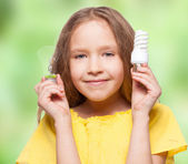 Child with bulbs — Stock Photo