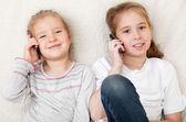 Children talking on mobile phone — Stock Photo