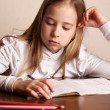 Girl doing homework — Stock Photo #46010079