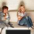 Mother with adult daughter watching television — Stock Photo #46317851