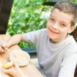 Child eating soup — Stock Photo #46933621