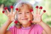 Little girl with raspberry — Stock Photo