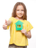 Girl holding a green house — Stock Photo