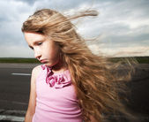 Sad child near road — Stock Photo