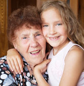 Elderly woman with great-grandchild — Stock Photo