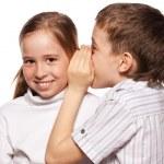 Boy whispers girl in the ear secret — Stock Photo #49878827