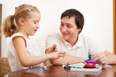 Girl and dad molded from clay toys — Stock Photo