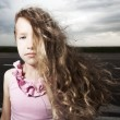 Sad child near road — Stock Photo #50989277