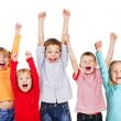 Happy kids with their hands up — Zdjęcie stockowe #50989301
