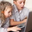 Surprised child with laptop — Stock Photo #9054122