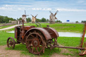 Old tractor and windmills. Estonia — Stock Photo