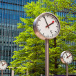 Canary Wharf Clocks. London, UK — Stockfoto