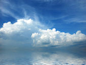 White fluffy clouds in blue sky — Stock Photo