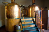Line of two traditional brewing vessels in brewery. — Stock Photo