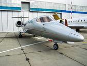 Private Jet in hangar — Stock Photo