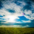 Field and sunset sky — Stock Photo #43157951