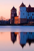 Old castle near lake in the evening — Stock Photo