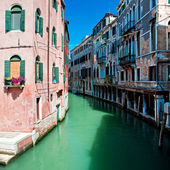 View of beautiful venice canal with houses standing in water — Stock Photo