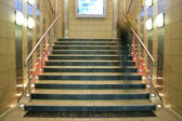 Wide staircase with moving person — Stock Photo