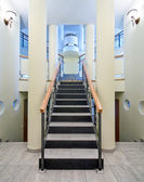 Luxury hall with staircase in a new private house — Stock Photo