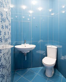 Interior of a new toilet room in blue colors — Stock Photo