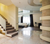 Luxury hall with staircase in a new house — Stock Photo