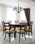 Fragment of living room interior with table for dinner — Stock Photo