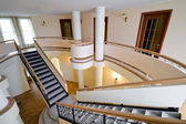 Interior of new mansion with staircase and balcony indoors — Stock Photo