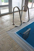 Ladder in swimming pool — Stock Photo