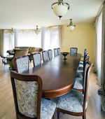 Interior of living room with big table for dinner — Stock Photo
