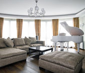 Interior of light living room with white piano — Стоковое фото