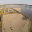 Flight over soline in Slovenia, place of extraction of sea salt, aerial panoramic view. — Stock Video #51035941