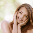 Smiling beautiful young woman — Stock Photo #12608989