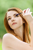 Young woman with bare shoulders eyes colors — Stock Photo