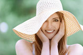 Smiling beautiful young woman in summer cap — Stock Photo