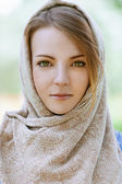 Alm beautiful young woman in head scarf — Stock Photo